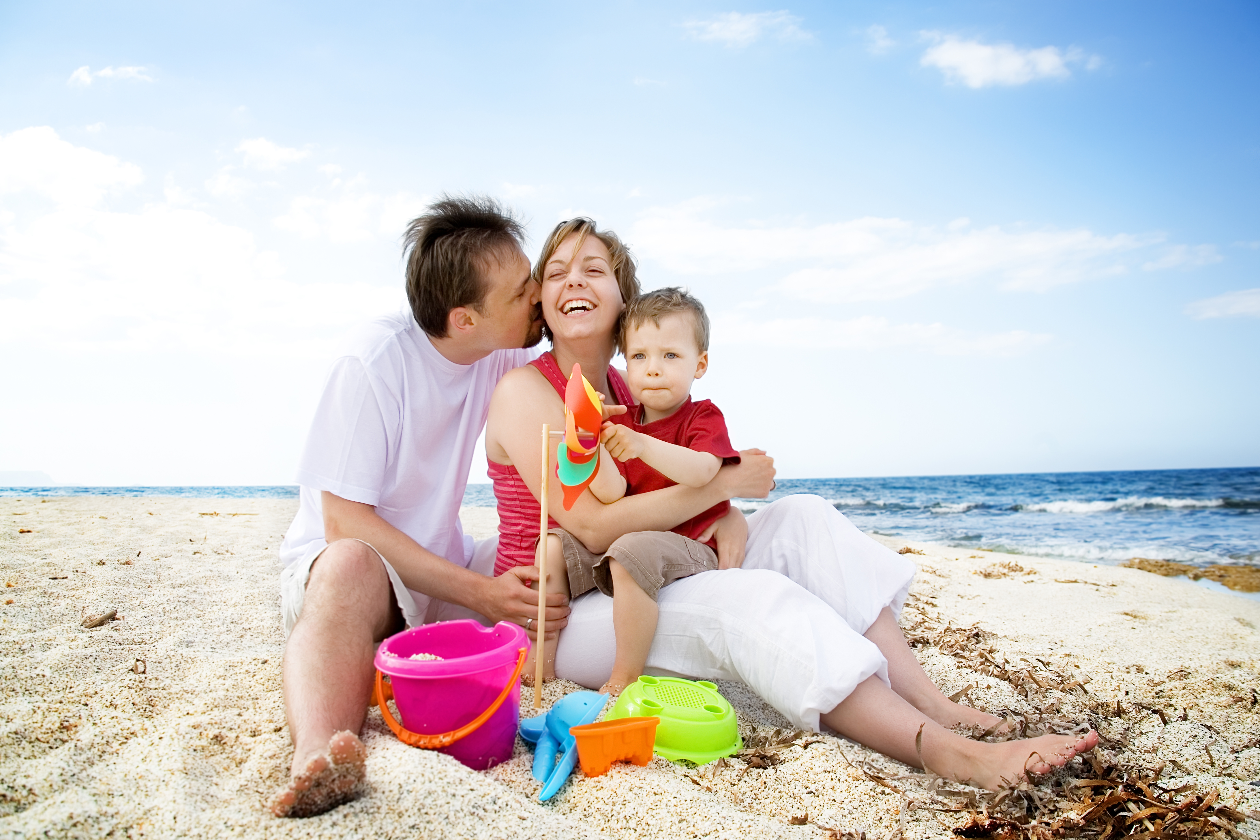 Parents and Son Laughing on the Beach